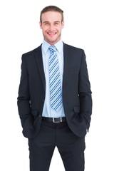 Smiling elegant businessman with hands in pockets