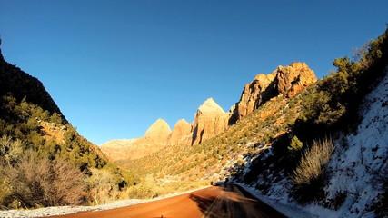 POV driving snow landscape dry climate vehicle transport Zion National Park Utah USA
