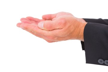 Businessman holding his hands out