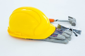 Protective gloves with hammer, glasses and yellow hard hat