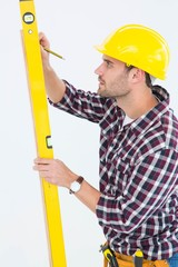 Technician marking while using spirit level