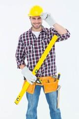 Confident handyman holding spirit level