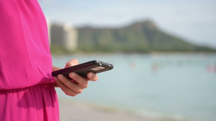 Phone - woman using smartphone outdoor on beach