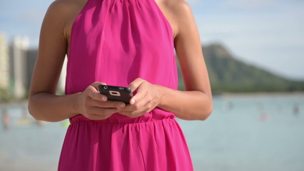 Smart phone woman using smartphone app on beach