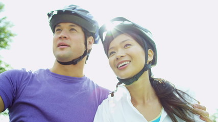 Close Up Asian Chinese Couple Exercise Outdoors Bicycles