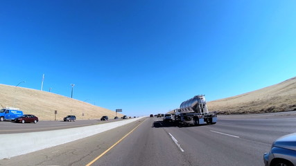 POV driving rural environment built structure Freeway vehicle USA