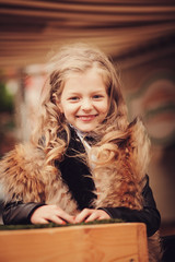 portrait of a smiling little girl in the city