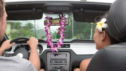Couple driving car on Hawaii travel - Hula doll