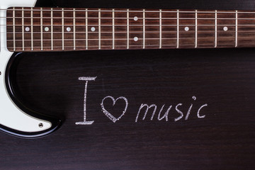 """text """"I love music"""" against the backdrop of guitar"""