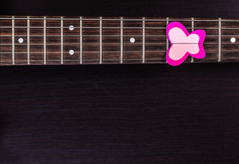 Electric guitar deck with paper butterfly