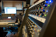 several mixing consoles in a recording studio - 76972208