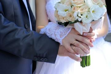 Bridal Bouquet; married couple holds bridal bouquet