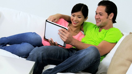 Relaxed Ethnic Couple Wireless Tablet Social Media