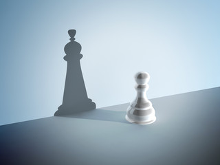 Chess pawn with the shadow of a queen