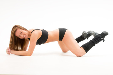 athletic girl with her knees pressed