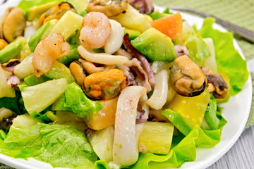 Salad seafood and lettuce on light board
