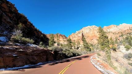 POV vehicle road trip winter snow Mountain cliffs Zion National Park Utah USA