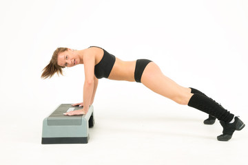sport girl push-ups of step and smile