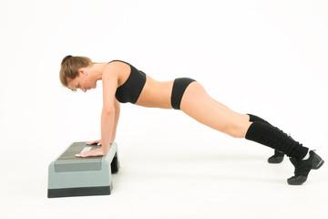 sport girl push-ups of step