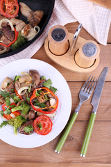 Braised wild mushrooms with vegetables and spices in pan and