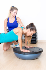 Two women making push ups