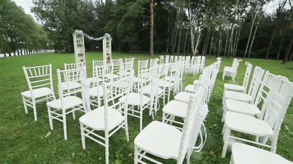 Rows of chairs outdoor wedding ceremony. Steadicam
