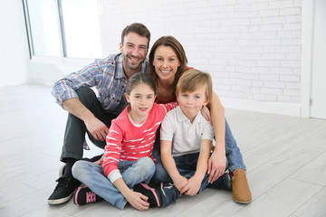 Family of four sitting on the floor