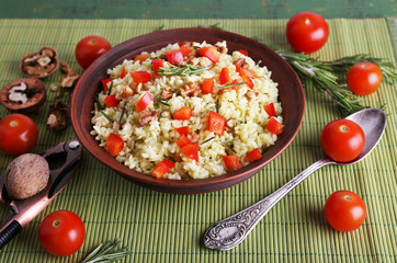 Rice with walnuts and cherry tomatoes in plate