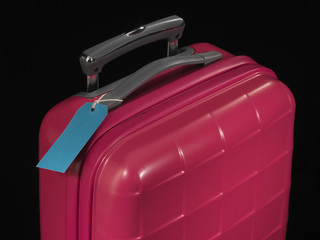 pink suitcase and blue tag