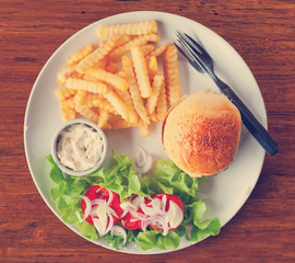 burger with French fries on the table in a cafe