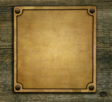 Bronze plaque on wooden background