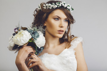 Beautiful bride with a bouquet of flowers