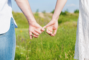 Young Couple Holding Hands Outdoors. Love