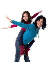 happy mother carrying daughter as airplane flying