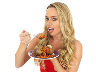 Young Woman Eating a Jacket Potato with Baked Beans