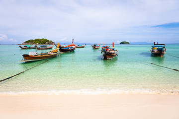 Traditional thai boats on the beach, Thailand