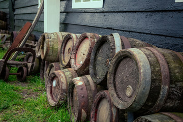 oak barrels of beer near the House