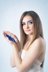 Portrait of a beautiful young woman with bright blue eyes