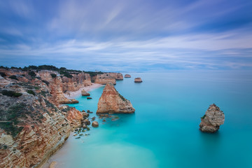 Beautiful seascape with unreal sky blue colors. Portugal,.