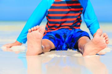 child feet on summer beach
