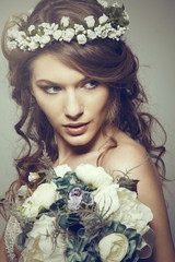 Beautiful bride with a bouquet of flower. Retro Style