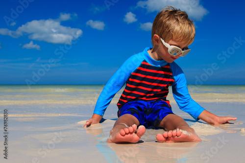 canvas print picture feet of little boy having fun on summer beach