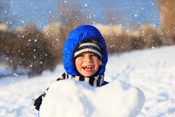 happy little boy outdoors on winter snow day