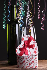 St Valentine's setting with present and red wine, love, gift