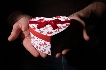 St Valentine's setting with present gift in hands