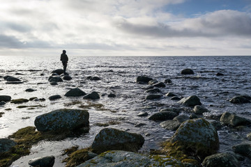 Man fishing alone in the spring sea