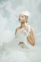 Bride over the sky background. Vintage style.