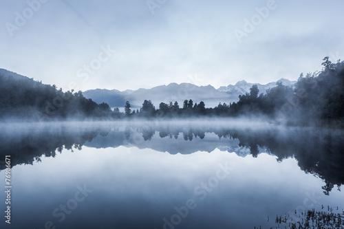 Beautiful reflections of Southern Alps at Lake Matheson - 76986671