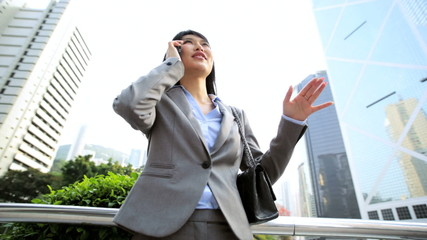 Ethnic Asian Chinese Woman Business Suit Outdoors Wireless Cloud Hotspot