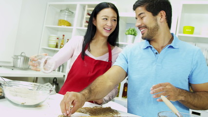 Close Up Happy Young Ethnic Couple Home Kitchen Biscuit Baking